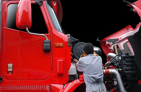 Man working on a red truck